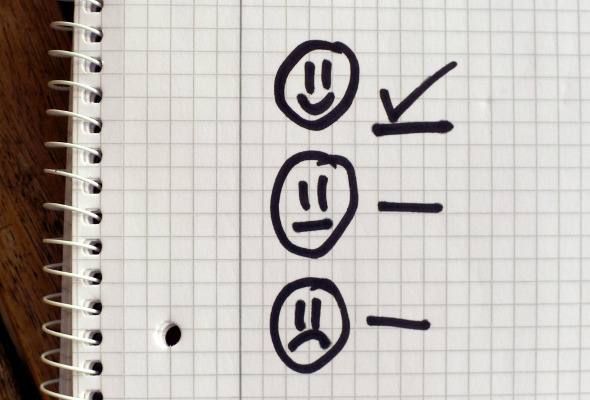 Drei Smileys: Je ein lachendes, neutrales und trauriges Gesicht.